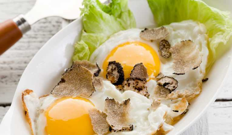 eggs with truffle over green salad